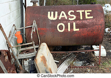 Waste Oil - A waste oil tank sits outside an automative...