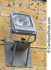 Halogen spotlight lamp on the wall