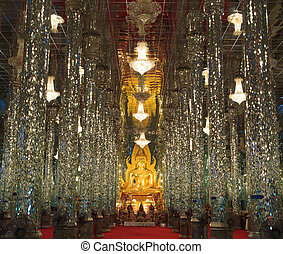 Golden Buddha statue at Cathedral glass, Temple in Thailand