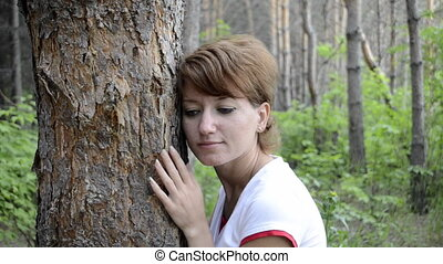 Sad young woman in autumn forest