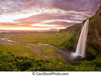 Seljalandsfoss is one of the most beautiful waterfalls on...