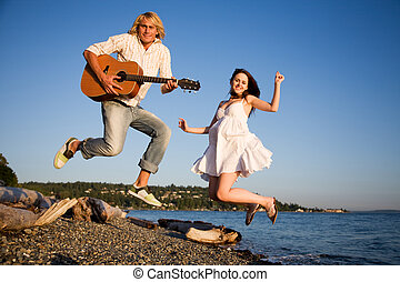 Jumping couple in happiness