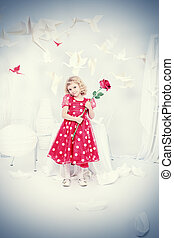 little girl - Cute little girl standing with a red rose...