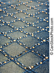 jeans with rhinestones - closeup shallow depth of field...