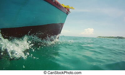 Speedy boat splash ride in tropical - cruising boat vessel...