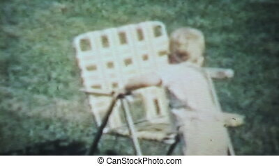 Boy Playing Outside-1963 Vintage - A cute little boy enjoys...