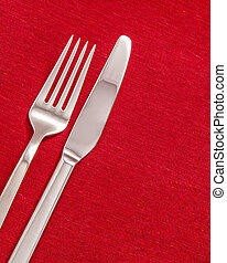 Silver cutlery - Silver Fork and knife on red table cloth