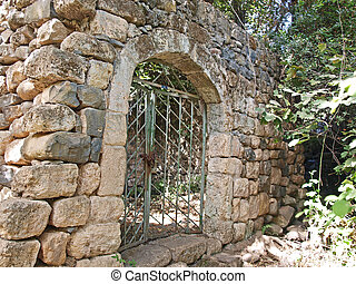Old stone wall with metal door - Old antique Arabic style...