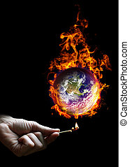 Put the world on fire - Hand holding a match and the planet...