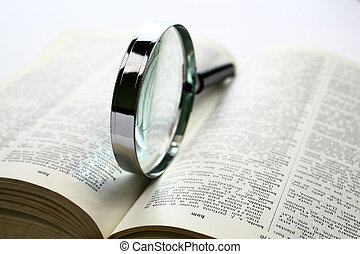Searching for knowledge - Magnification glass over a opened...