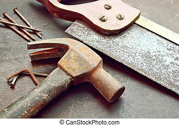 Work tools - Six nails one hammer and a handsaw