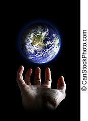 World in your hands - Earth hovering above an hand