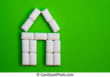 Home Sign on green - Set of gums aligned composing an house