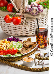 Main dish made with vegetables and meat kebab
