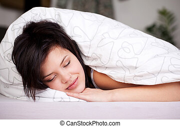 Smiling beautiful girl asleep in bed - Smiling beautiful...