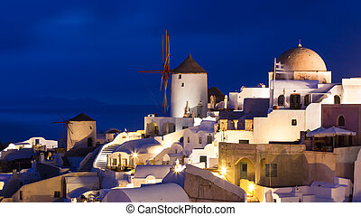 Dusk at Oia Santorini Greece - Traditional windmills at...