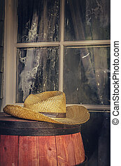 Wild west cowboy hat - Cowboy hat sitting on barrel outside...