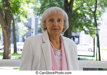 elderly woman in park, 83 years old