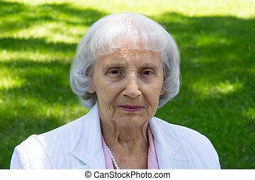 elderly woman portrait - 83 years old woman outdoor portrait