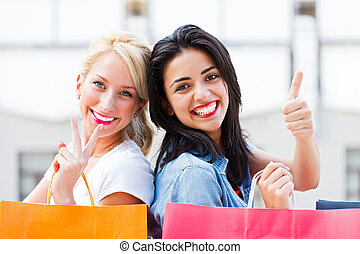 Girls Shopping - Smiling girlfriends together out in town...