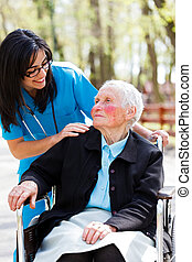 Nursing Home - Beautiful doctor, nurse in blue coat walking...