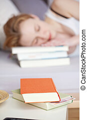 Woman with books fall asleep - Portrait of blurred sleeping...