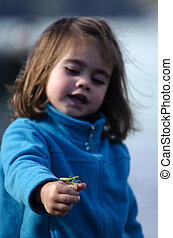 Children and wildlife - Little girl holds a Praying Mantis...