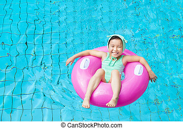 happy little girl in the swimming pool