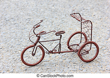 toy crafts bicycle made of copper wire on the ground