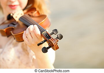 Female hand with a violin outdoor - Female hand music lover...