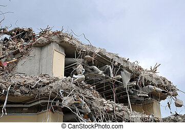Side of building in process of being demolished with...