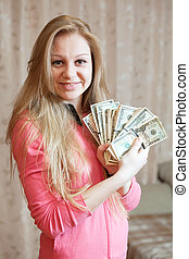 Happy woman shows US dollars - Happy young woman shows...