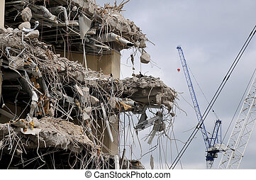 Demolition and cranes - Building partially demolished with...