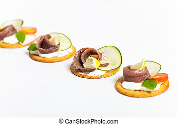 Canapes with pickled anchovy filet
