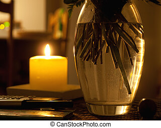Romantic candle lights with a flowers vase