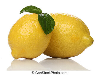 Two lemons isolated over white background