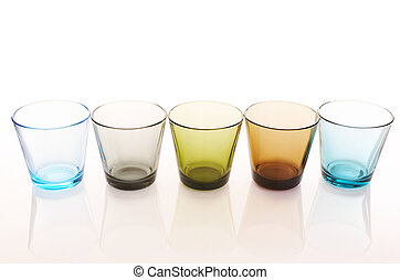 Glasses - Colorful water glasses over a white reflective...