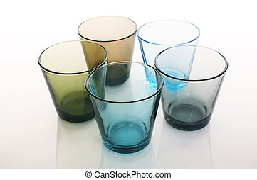 Glasses - Colorful water glasses in circle formation over a...