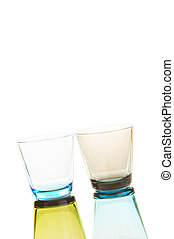 Glasses - Colorful empty water glasses stacked over a white...