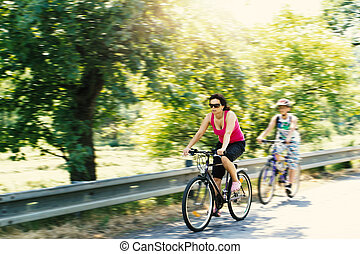 Mother with sons on bicycle trip