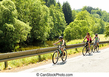 Mother with two sons on bicycle trip