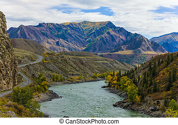 river in the mountains - the river and the road in the...