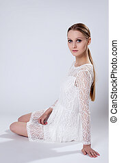 Romantic young girl posing in elegant dress