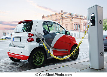 Electro car is charging on the street No logos or car...