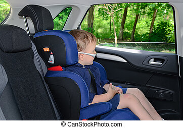 Little boy sitting in car seat