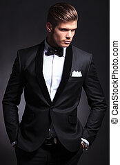business man looks away - waist-up picture of an elegant...