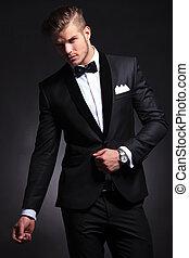 business man posing with hand on tuxedo jacket - elegant...