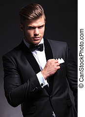 business man holds his pocket handkerchief - elegant young...