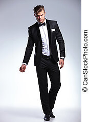 business man in fashion tuxedo - full length picture of an...