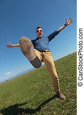 casual man balancing outdoors - casual young man standing in...